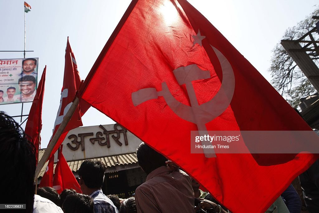 Trade union activists carrying Communist party flag participate in march in support of 48 hours strike called by 11 national trade unions against the UPA Government's economic and alleged anti-labour policies on February 20, 2013 in Mumbai, India.