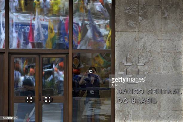 Trade union members wave flags during a demonstration in front of Brazil's Central Bank building at the financial centre of Paulista Avenue in Sao...