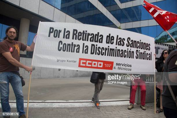 Trade unionists show a banner that says For the withdrawal of sanctions against union discrimination Workers protest against the sanctions put by The...