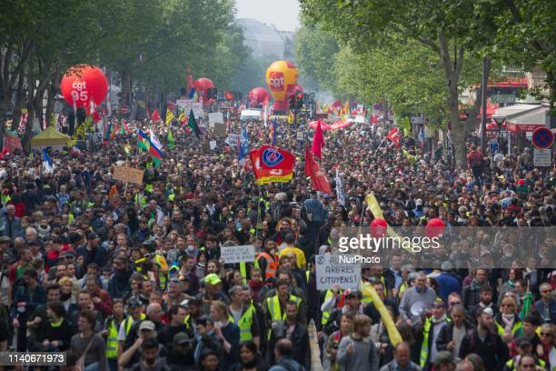 Trade unionists workers and Yellow vests protesters march during May 1st day against the policies of the french President Emmanuel Macron in Paris on...