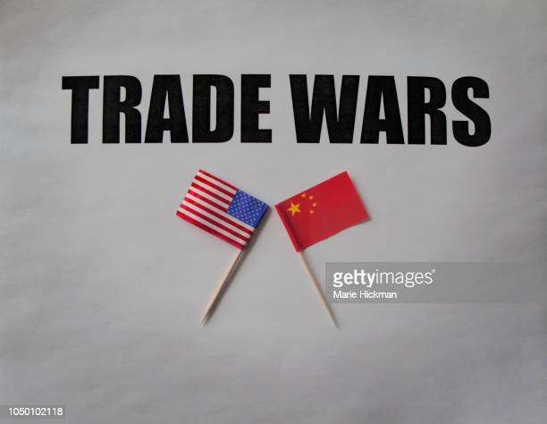 trade wars with u.s flag and chinese flag. - us china trade war stock pictures, royalty-free photos & images