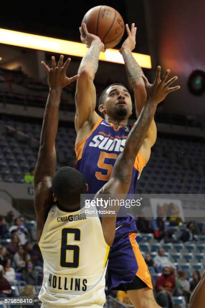 TraDeon Hollins of the Fort Wayne Mad Ants battles Josh Gray of the Northern Arizona Sunns during their NBDL game at Memorial Coliseum on November 26...