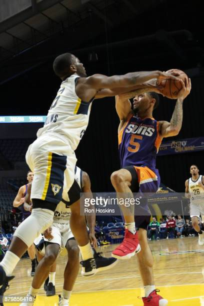 TraDeon Hollins of the Fort Wayne Mad Ants battles Josh Gray of the Northern Arizona Suns during their NBDL game at Memorial Coliseum on November 26...