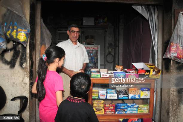 Trader Abu Adel standing in his small shop which he opened in an abandoned house in the former battleground of Aleppo Syria 23 June 2017 He comes...
