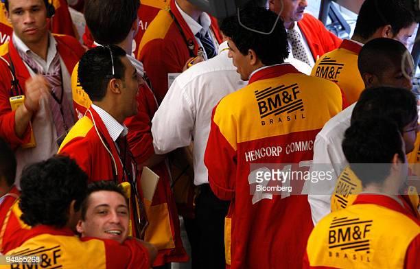 Trader assistants work on the floor of the Bolsa de Mercadorias e Futuros or Brazilian Mercantile and Futures Exchange in Sao Paulo Brazil on Monday...