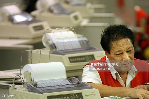 A trader at the Hong Kong Stock Exchange looks dejected during the trading day 16 August 2007 Hong Kong share prices closed sharply lower down 33...