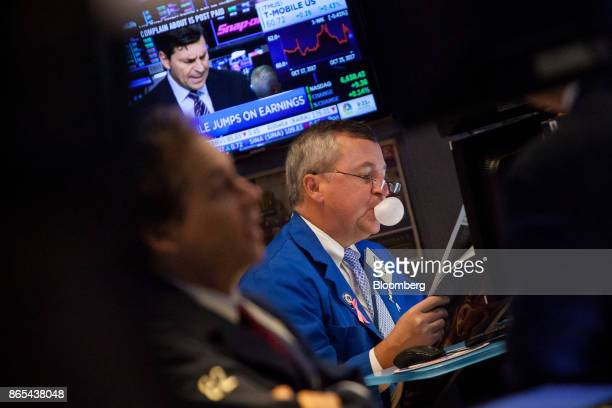 A trader blows a bubble while chewing gum on the floor of the New York Stock Exchange in New York US on Monday Oct 23 2017 US stocks got off to a...