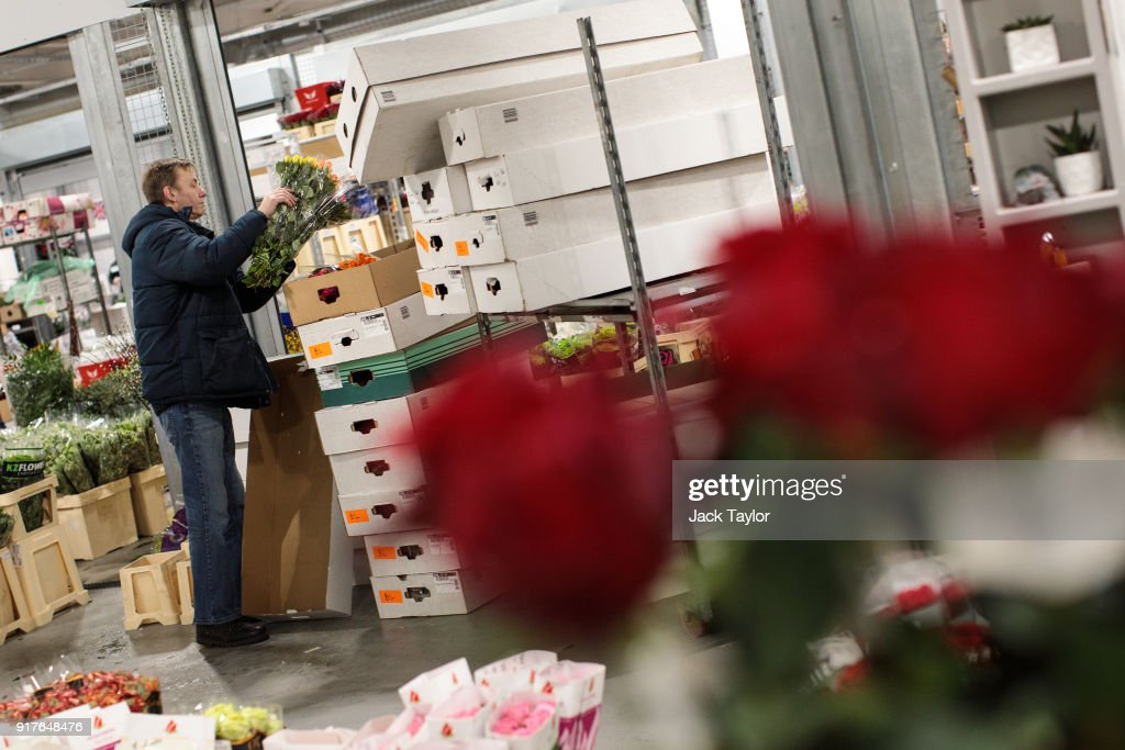 A trader boxes bunches of flowers up at New Covent Garden Flower Market ahead of Valentine's Day on February 13, 2018 in London, England. New Covent Garden market is the largest wholesale fruit, vegetable, and flower market in the United Kingdom, supplying 75% of florists in London.