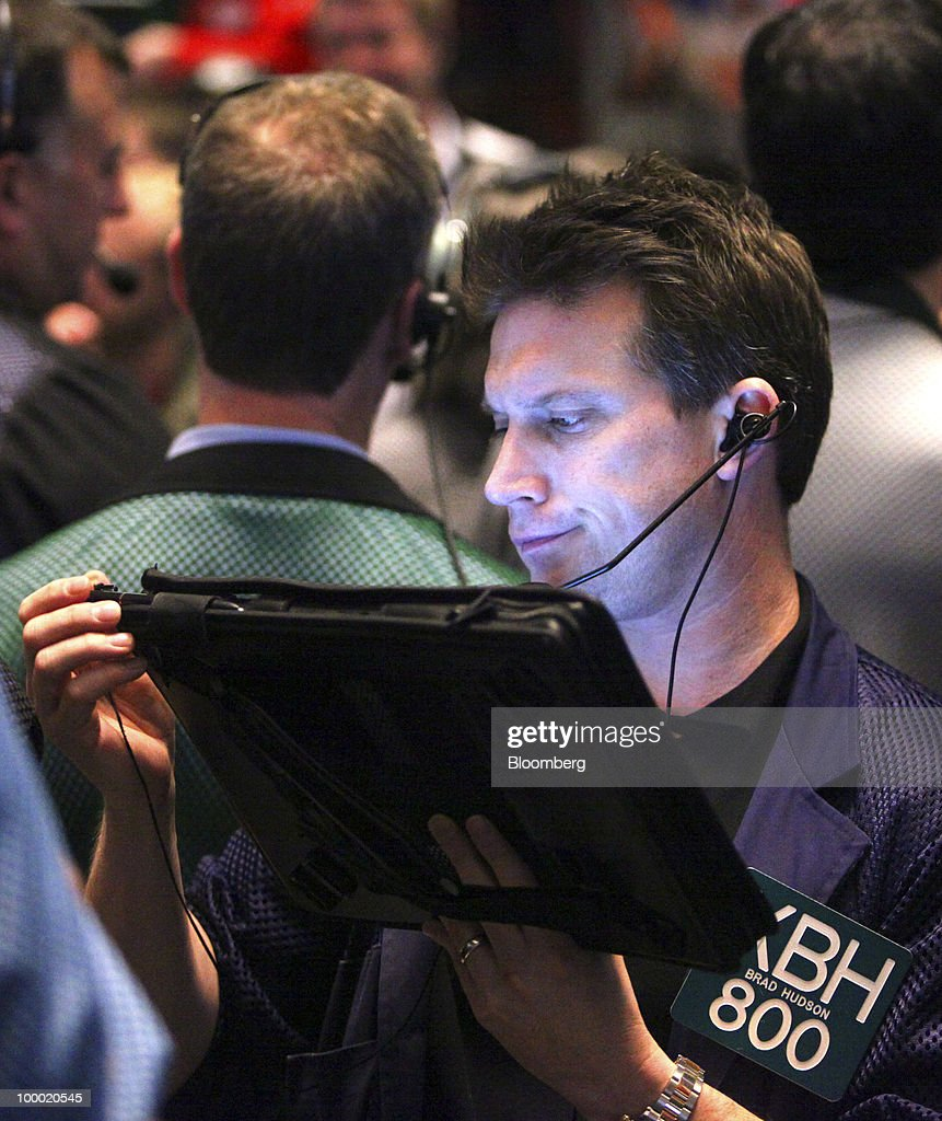 Trader Brad Hudson looks at his electronic tablet in the Eurodollar options trading pit at CME Group Inc.'s Chicago Board of Trade in Chicago, Illinois, U.S., on Thursday, May 20, 2010. The euro declined against the dollar on concern European governments are divided on how to contain financial turmoil in the wake of the sovereign-debt crisis. Photographer: Tim Boyle/Bloomberg via Getty Images Brad Hudson