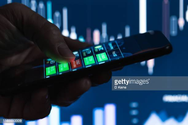 trader checking financial statistics - bringing home the bacon stock pictures, royalty-free photos & images