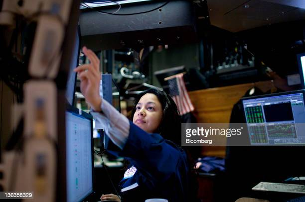 A trader checks her monitor floor of the New York Stock Exchange in New York US on Monday Jan 3 2012 Stocks surged driving the Standard Poor's 500...