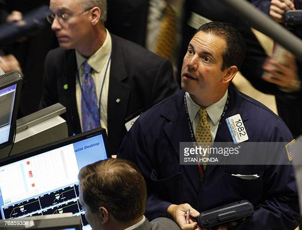 A trader checks prices on a monitor on the floor of the New York Stock Exchange after the opening bell 19 September 2007 in New York US stocks opened...
