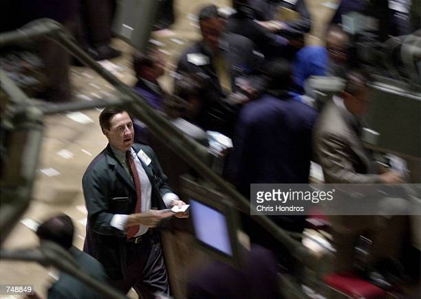 A trader dashes across the floor of the New York Stock Exchange May 22 2000 in New York The Dow Jones Industrial Average fell 8430 points to 1054255...