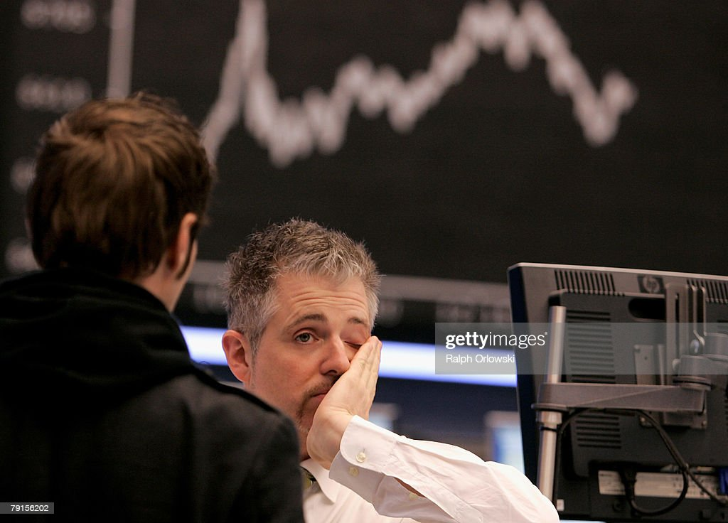 Trader Dirk Mueller reacts in front of the DAX Index board on the floor of the stock exchange during a trading session January 22, 2008 in Frankfurt, Germany. The German stock market remains volatile after stock markets in Asia fell by over 10 percent in the last two days.