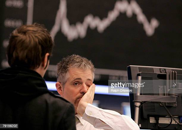 Trader Dirk Mueller reacts in front of the DAX Index board on the floor of the stock exchange during a trading session January 22 2008 in Frankfurt...