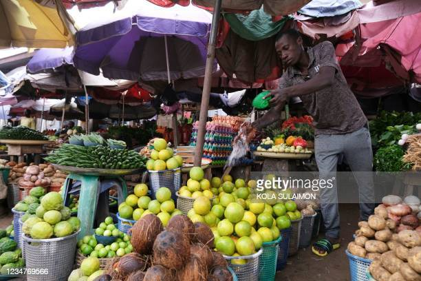 Trader display farm produce at Wuse Market, Abuja, Nigeria, on August 17, 2021. - Threatened by insecurity, farmers in Nigeria's farm belt are...