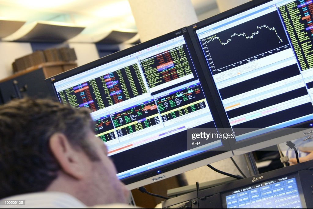 A trader from French financial services company Global Equities looks at computer screens where financial markets curves are scrolling on April 28, 2010 in Paris. Eurozone borrowing costs shot higher today, with Greek 10-year bond yields hitting a record above 11 percent, as the debt debacle in Athens sparked fears of a wider financial meltdown.