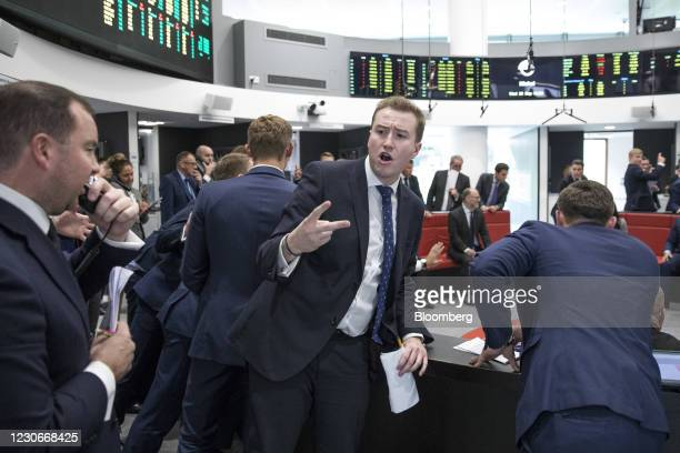 Trader gestures as he works from the trading floor of the open outcry pit at the London Metal Exchange Ltd. At Finsbury Square in London, U.K. On...