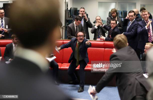 Trader gestures from inside the open outcry pit as he works on the trading floor of the London Metal Exchange at Leadenhall Street in London, U.K.,...