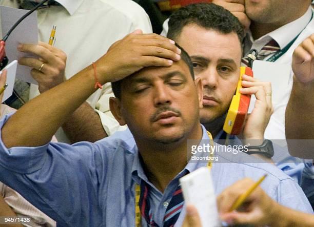 A trader gestures on the floor at the Brazilian Bolsa de Mercadorias e Futuros or Brazilian Mercantile and Futures Exchange in Sao Paulo Brazil on...