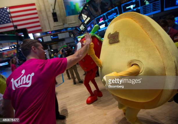 A trader greets a King Digital Entertainment Plc 'Candy Crush' character on the floor of the New York Stock Exchange in New York US on Wednesday...