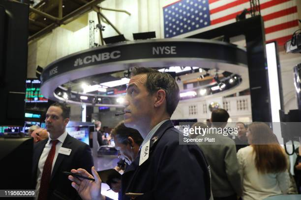 Trader Gregory Rowe works on the floor of the New York Stock Exchange during the beginning of the Christmas holiday week on December 23, 2019 in New...