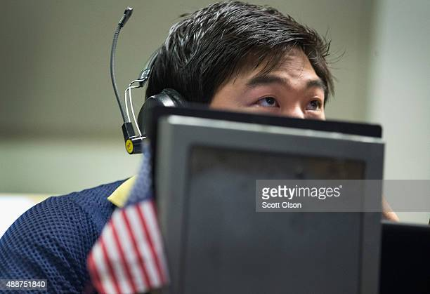 A trader in the Standard Poor's 500 stock index options pit at the Chicago Board Options Exchange waits for news to break on the Federal Reserve's...