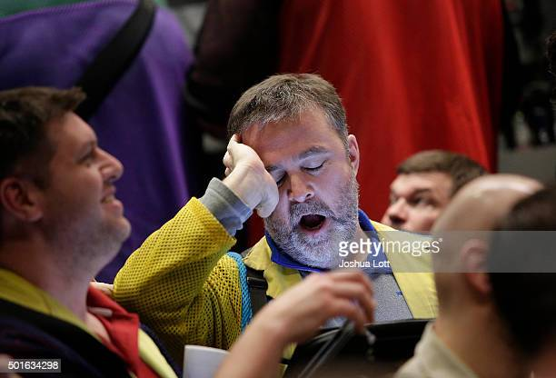 A trader in the Standard Poor's 500 stock index options pit at the Chicago Board Options Exchange yawns as he reacts to the Federal Reserves interest...