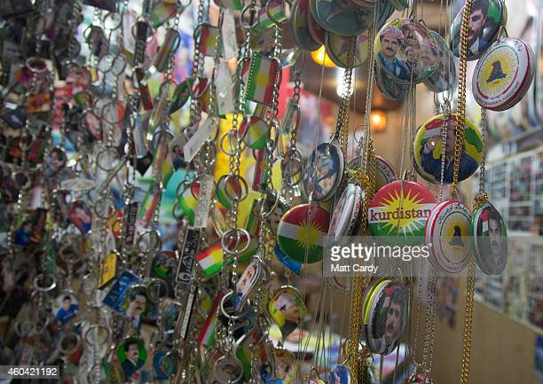 A trader inside the Qaysari Bazaar sells Kurdish badges on December 13 2014 in Erbil Iraq As insecurity continues throughout Iraq it was announced...