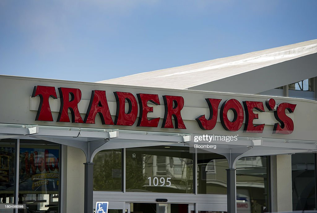 Trader Joe's Co. signage is displayed on the facade of a store in San Francisco, California, U.S., on Friday, Sept. 13, 2013. Trader Joe's Co., the closely held grocery store chain, will end health benefits for part-time workers next year, directing them instead to anew insurance marketplaces as companies revamp medical coverage to fit the U.S. Affordable Care Act. Photographer: David Paul Morris/Bloomberg via Getty Images
