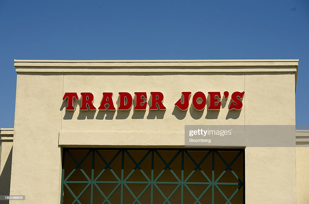 Trader Joe's Co. signage is displayed on the facade of a store in Emeryville, California, U.S., on Friday, Sept. 13, 2013. Trader Joe's Co., the closely held grocery store chain, will end health benefits for part-time workers next year, directing them instead to anew insurance marketplaces as companies revamp medical coverage to fit the U.S. Affordable Care Act. Photographer: David Paul Morris/Bloomberg via Getty Images