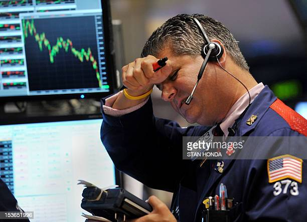 Trader John W Panin of JNK Securites Corp works on the floor of the New York Stock Exchange on August 4 2011 The Dow Jones Industrial Average plunged...
