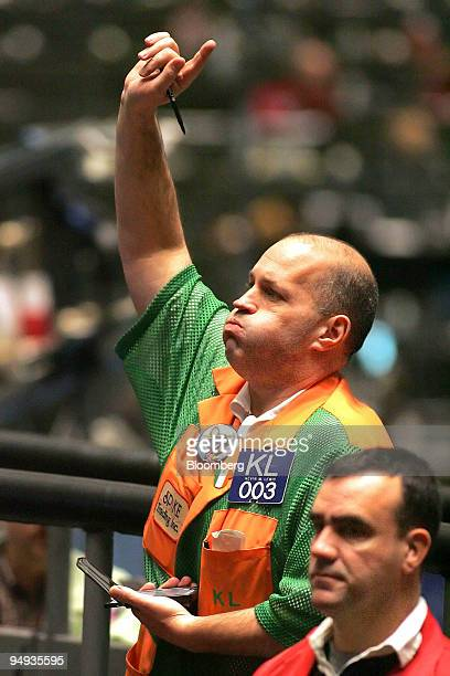 Trader Kevin Lewis signals an order in the SP 500 pit at the Chicago Board of Trade in Chicago Illinois US shortly after its opening on Friday Jan 2...