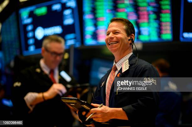 A trader laughs ahead of the closing bell on the floor of the New York Stock Exchange on February 1 2019 in New York City Wall Street stocks...