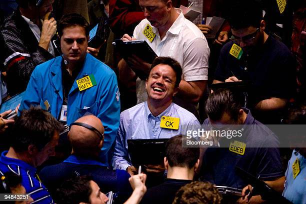 A trader laughs while working in the crude oil options pit at the New York Mercantile Exchange in New York US on Monday June 16 2008 Crude oil rose...