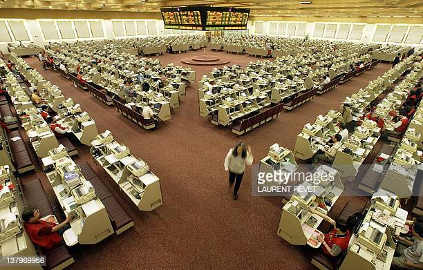 A trader leaves the floor at the close of trade at the Hong Kong Stock Exchange 19 September 2003 Hong Kong share prices closed 092 percent lower...