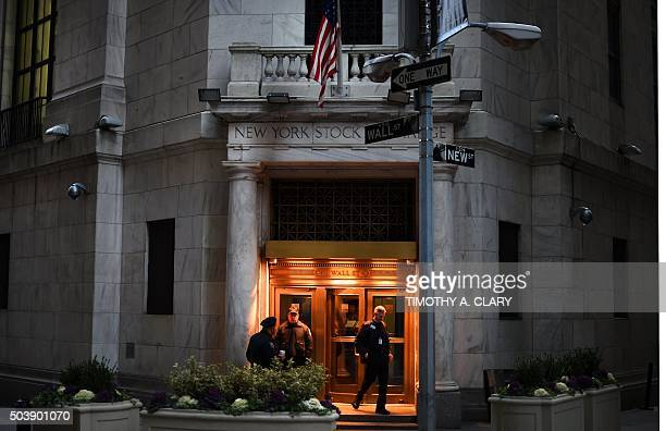 A trader leaves the New York Stock Exchange after the closing bell on January 7 2016 US stocks tumbled Thursday as another big drop in Chinese stocks...