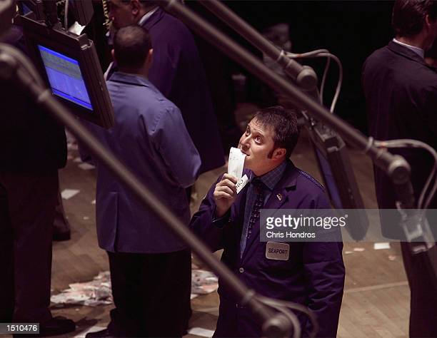 A trader looks at a monitor on the floor of the New York Stock Exchange in New York April 14 2000 Stocks plummeted Friday in a broad selloff as the...