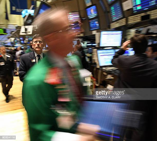 A trader looks at his monitor before the opening bell on the floor of the New York Stock Exchange March 19 2008 as VISA celebrates the largest IPO in...