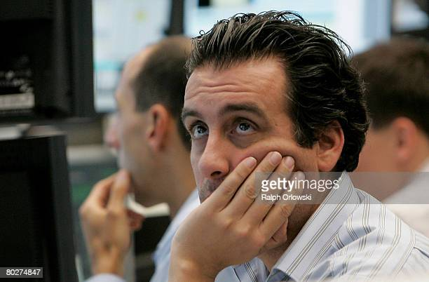 A trader looks on during a trading session on the floor of Frankfurt stock exchange on March 17 2008 in Frankfurt Germany Due to a weakness of the US...