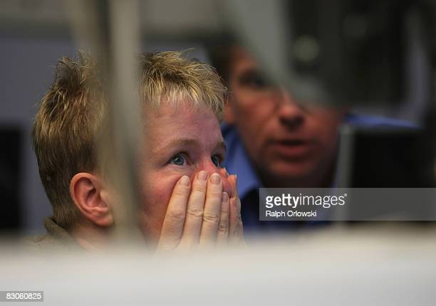 A trader looks on during a trading session on the floor of Frankfurt stock exchange on September 30 2008 in Frankfurt am Main Germany Due to the...