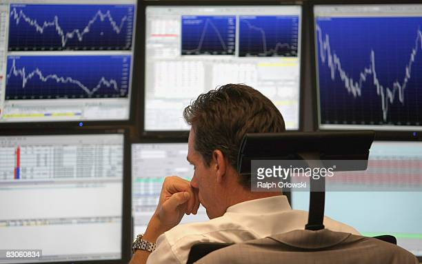 Trader looks on during a trading session on the floor of Frankfurt stock exchange on September 30, 2008 in Frankfurt am Main, Germany. Due to the...