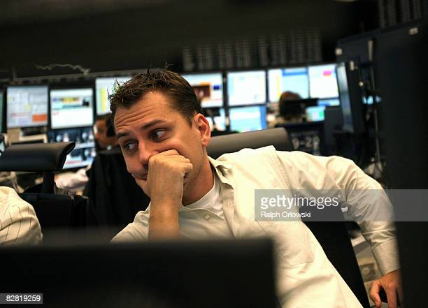 A trader looks on during a trading session on the trading floor at Frankfurt stock exchange on September 15 2008 in Frankfurt Germany Due to collapse...