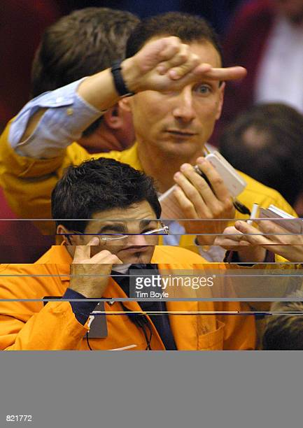 Trader Michael A Palmer bottom contemplates a trade in the Eurodollar Futures pit of the Chicago Mercantile Exchange March 20 2001 as the Federal...