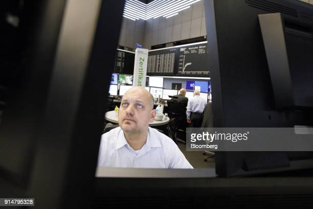 A trader monitors financial data inside the Frankfurt Stock Exchange operated by Deutsche Boerse AG in Frankfurt Germany on Tuesday Feb 6 2018 The...