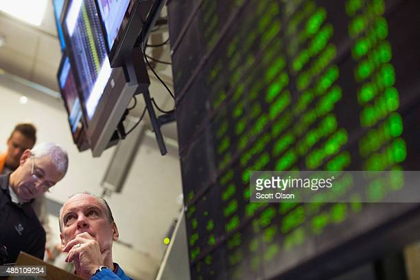 A trader monitors offers in the Standard Poor's 500 stock index options pit at the Chicago Board Options Exchange on August 24 2015 in Chicago...