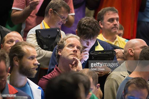 A trader monitors trades in the Standard Poor's 500 stock index options pit at the Chicago Board Options Exchange following news that the Federal...