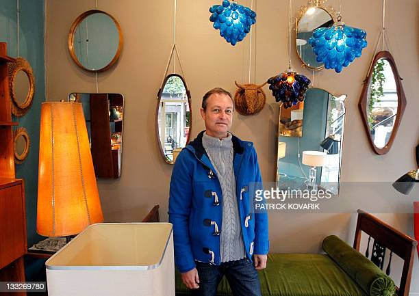 Trader of the Paris' famous SaintOuen flea market Vincent Vauban poses in his stall located in the PaulBert part of 'Les Puces' bricabrac market on...