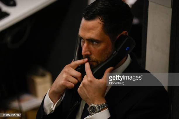 Trader on phones on the trading floor of the open outcry pit at the London Metal Exchange Ltd. In London, U.K., on Monday, Sept. 6, 2021. After 18...