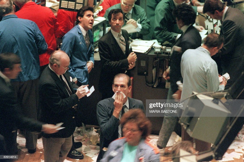 A trader (c) on the New York Stock Exchange gathers his thoughts 16 October 1987 as the Dow Jones Industrial Average dropped a record 108. 36 in one day trading record.